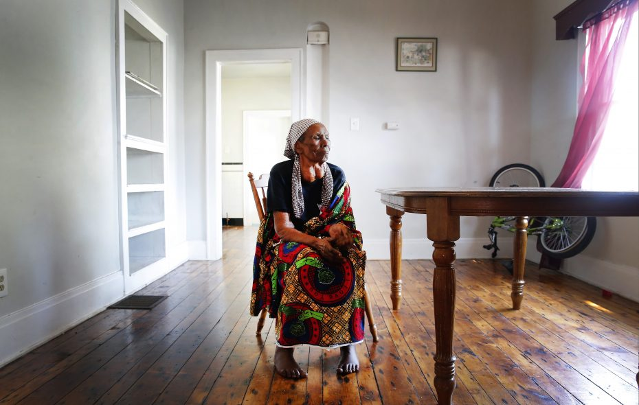 Rebecca Ngombwa, 111 years old, reflects on the pain and suffering she has witnessed for over a century during an interview with family members who escaped war-torn Congo in Africa and made their new home in Buffalo.  (Robert Kirkham/Buffalo News)