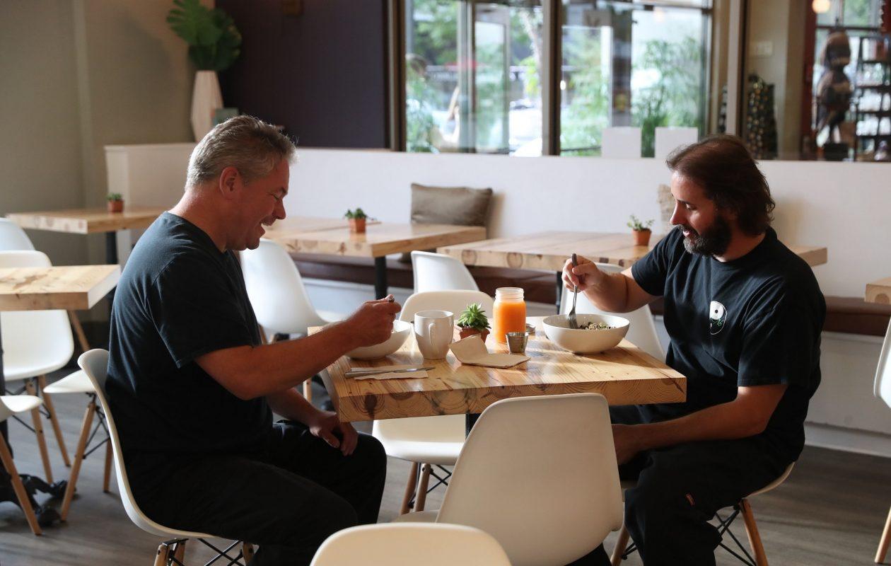 Eric Reczek, left, and Daniel Cimino of Hamburg have dinner at Prima Cafe at Prima Oliva. (Sharon Cantillon/Buffalo News)