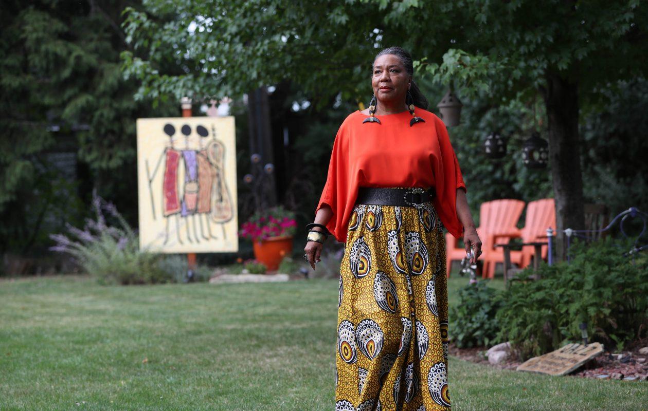 Dawn Martin Berry-Walker takes a stroll in the backyard at her home in Buffalo. (Sharon Cantillon/Buffalo News)
