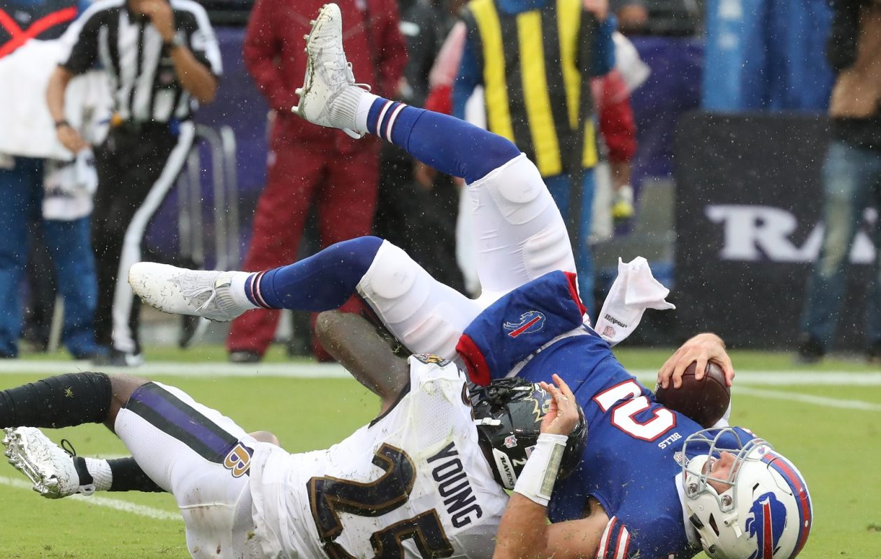 Bills quarterback Nathan Peterman is sacked in the first half against the Ravens. (James P. McCoy/Buffalo News)