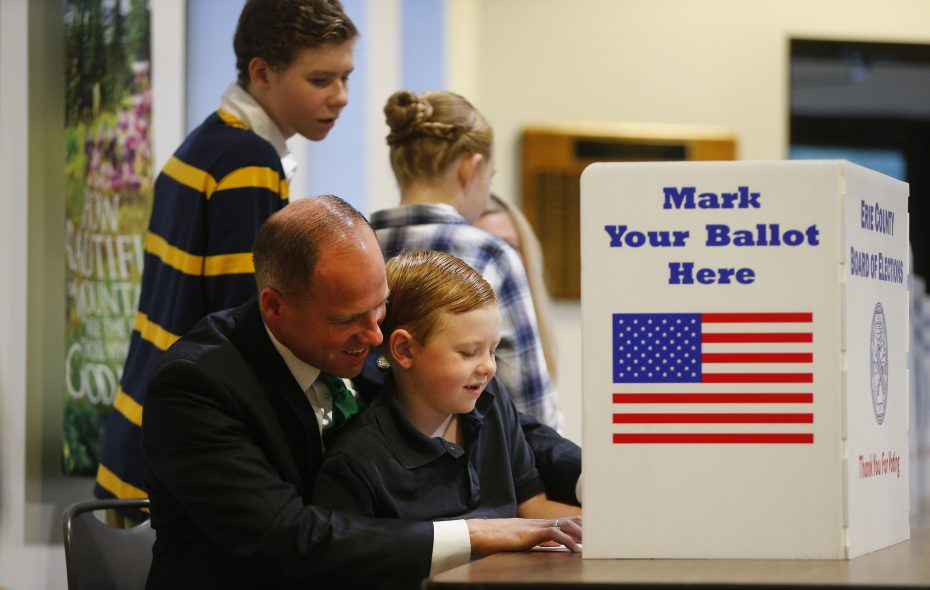 State Sen. Tim Kennedy, voting with his son, Padraic, is ready to capitalize on the State Senate attaining a Democratic majority.   (Mark Mulville/Buffalo News)