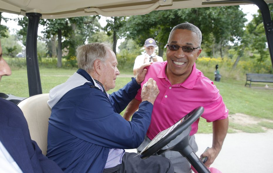 Jack Nicklaus signs the shirt of Danny Mendez, a golfer in Delaware Park, during Nicklaus' tour on Sept. 17. (Robert Kirkham/Buffalo News)