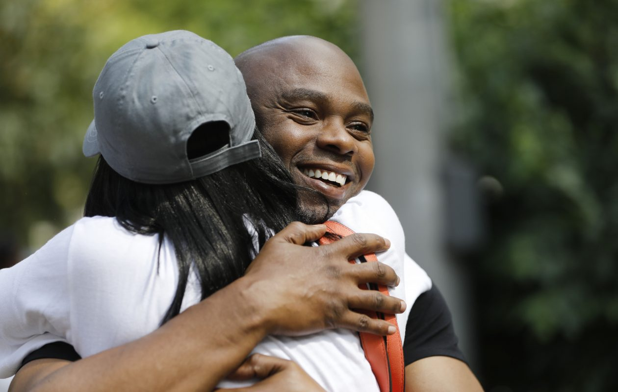 Valentino Dixon, who served almost 27 years in prison for a murder he didn't commit, is greeted by family and friends as he walks out of Erie County Court after his sentence was vacated on Wednesday. (Derek Gee/Buffalo News)
