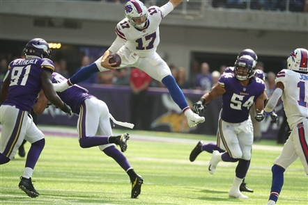 Among the most memorable moments of the Buffalo Bills' 27-6 win over the Minnesota Vikings Sunday: Bills quarterback Josh Allen's hurdle over Minnesota Vikings linebacker Anthony Barr for a first down in the first quarter. After Buffalo News photographer James P. McCoy captured this stunning viral photo of the hurdle on Sept. 23, 2018, we asked readers to send us their best captions. Send your caption or meme ideas to Qina Liu at qliu@buffnews.com to be included.