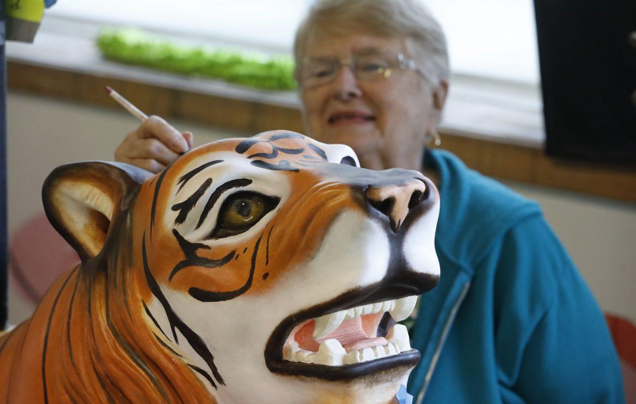 Painter Barb Wheeler works on the tiger at the Buffalo Heritage Carousel workshop in North Tonawanda on Monday, Sept. 24, 2018. (Derek Gee/Buffalo News)