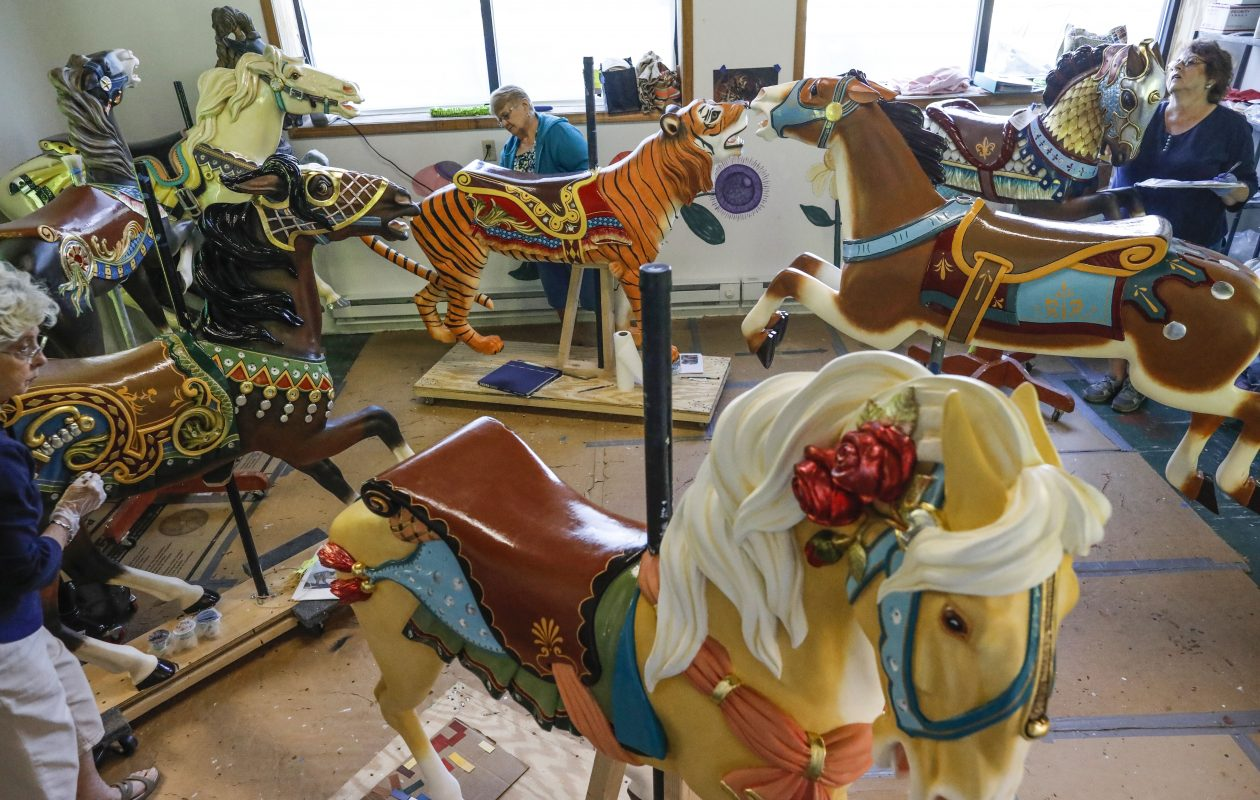 Painters Jan Bough, left, Barb Wheeler, center, and Christine Kasprzak, right, work on the assortment of animals in the paint room at the Buffalo Heritage Carousel workshop in North Tonawanda, Monday, Sept. 24, 2018. (Derek Gee/Buffalo News)