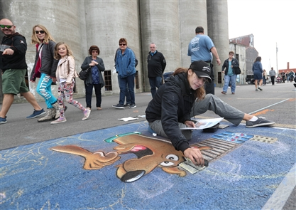 Chalk creations were inside and outside of the grain silos at RiverWorks for the first day of ChalkFest Buffalo, Saturday, Sept. 22, 2018. Many of the chalk drawings had a Halloween theme.