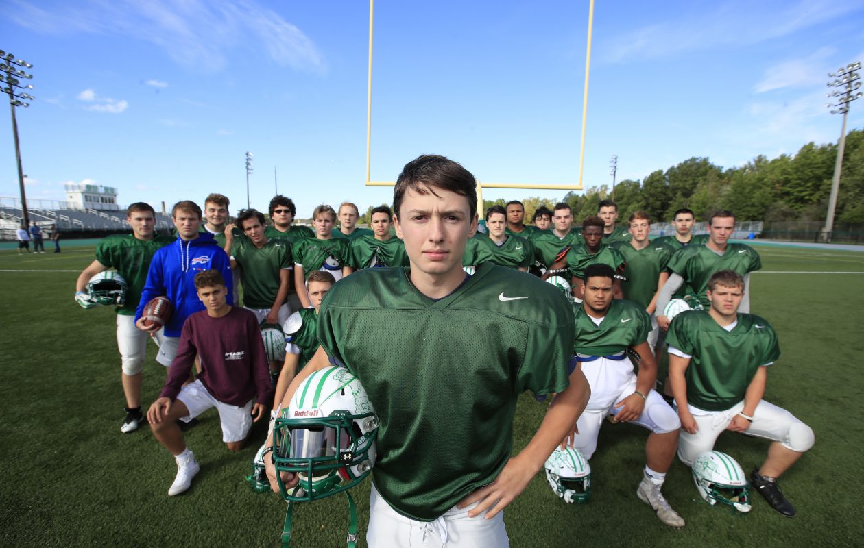 Lewiston-Porter football player Frank Previte IV stands with his football team after his mother Janice passed away last Wednesday at Roswell Park Hospital from leukemia. (Harry Scull Jr./ Buffalo News)