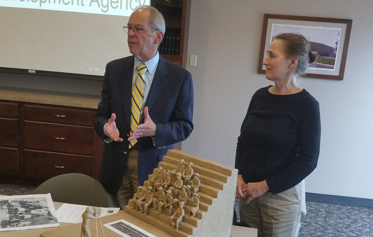 David R. Kinyon, left, president of the Locks Heritage District Corp., and Youngstown sculptor Susan Geissler show a model of the Lock Tenders Tribute statues to the Host Communities Standing Committee in Wheatfield on Sept. 25, 2018. (Thomas J. Prohaska/Buffalo News)