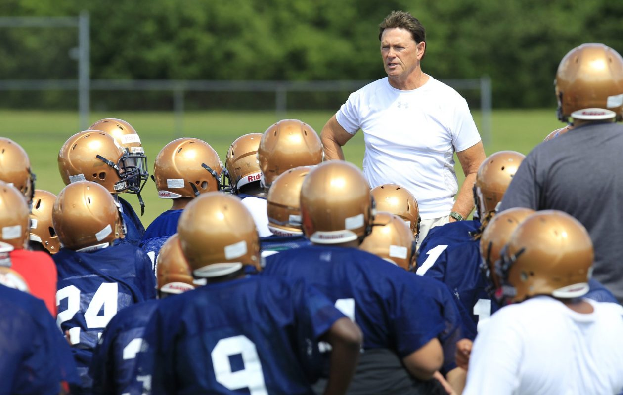 Sweet Home football coach John Faller talks to his team during a 2014 practice. (Harry Scull Jr/News file photo)