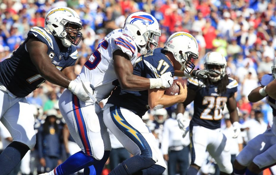 Bills' Jerry Hughes sacks Chargers quarterback Philip Rivers. (Harry Scull Jr./Buffalo News)