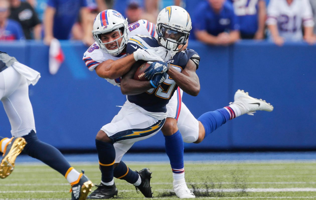 Bills linebacker Matt Milano tackles Chargers wide receiver JJ Jones  (Mark Mulville/Buffalo News)