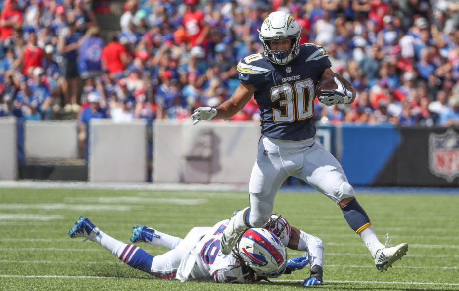 Chargers running back Austin Ekeler runs past Bills linebacker Tremaine Edmunds. (James P. McCoy/Buffalo News)