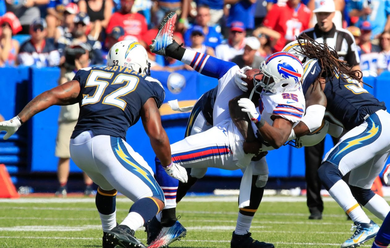 Buffalo Bills running back LeSean McCoy gets wrapped up by the Los Angeles Chargers defense during the third quarter. (Harry Scull Jr./Buffalo News)