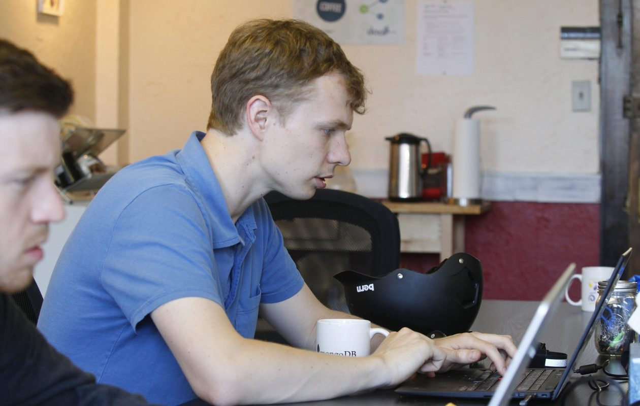 Kevin Purdy works on his computer at CoworkBuffalo, on Delaware Avenue in 2013. (Harry Scull Jr./Buffalo News)