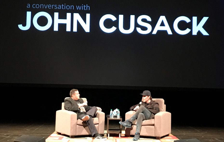 John Cusack, right, talks with local radio personality Nicholas Picholas during an event at the University at Buffalo Center for the Arts.