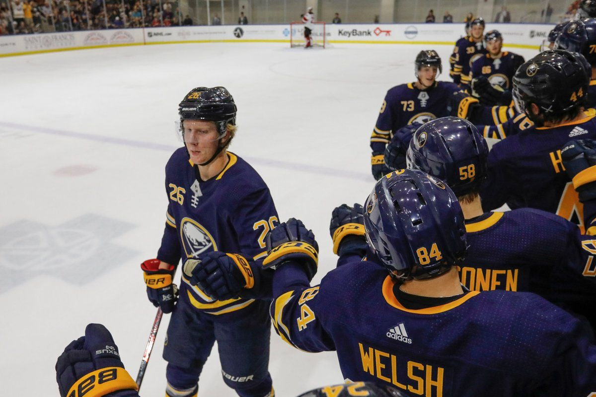 Teammates give it up to Rasmus Dahlin after a training camp goal. (Derek Gee/News file photo)