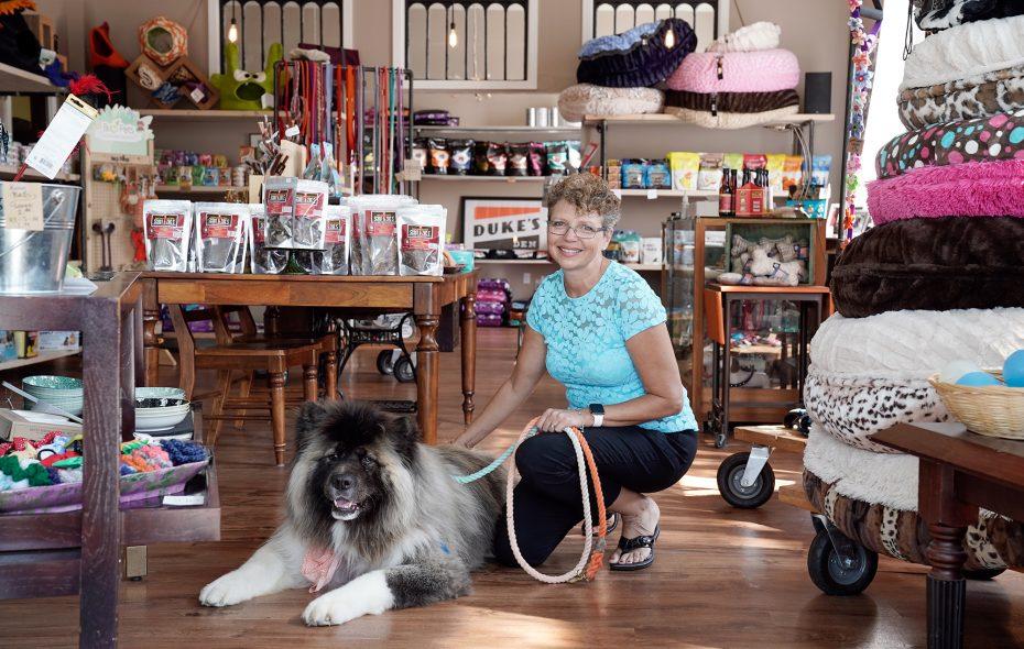 Daisy, Lisa Samar's longhaired Akita, is the namesake of Samar's Hertel Avenue store, Daisy's Doghouse. (Dave Jarosz)