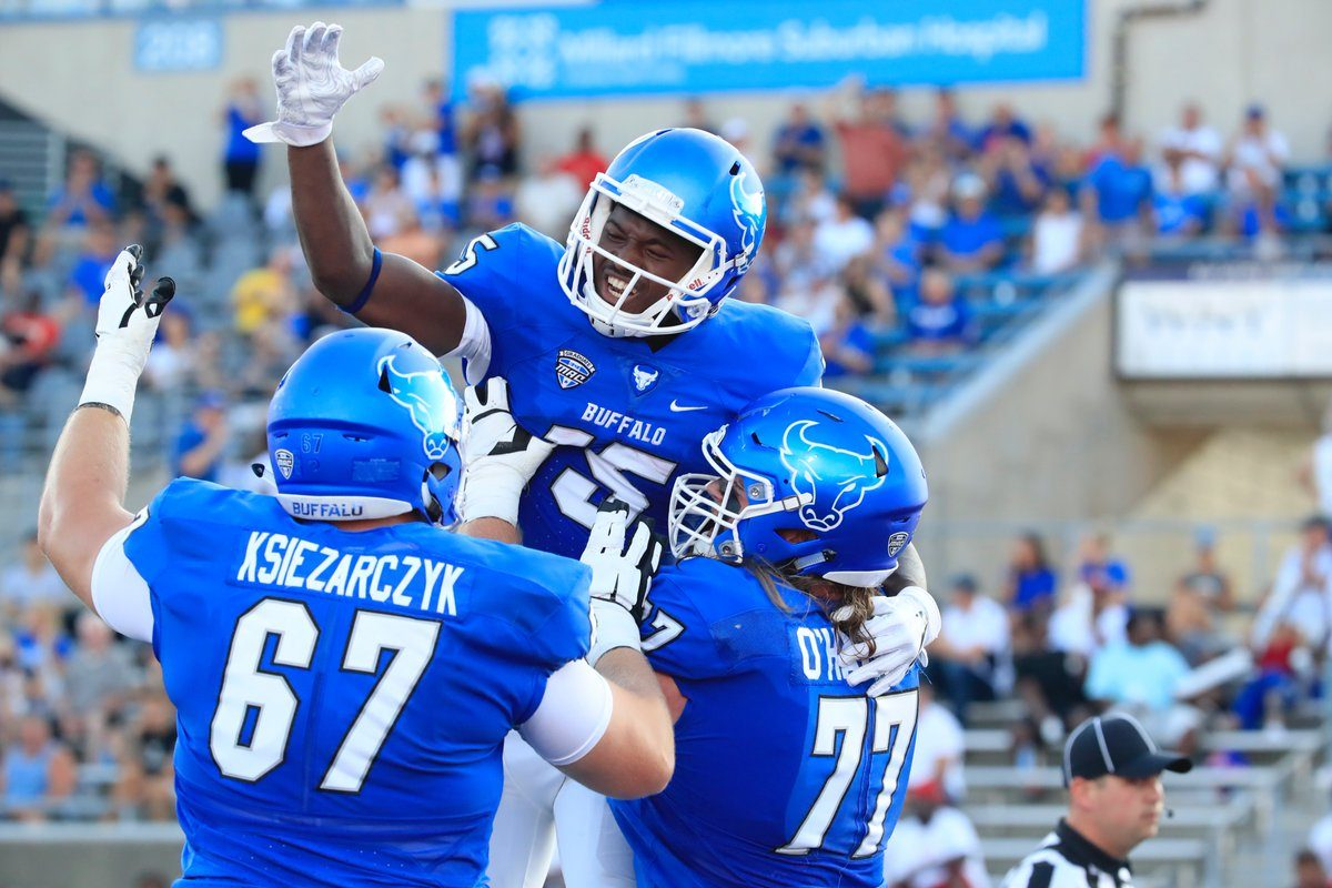 Wide receiver George Rushing celebrates with teammates after one of his two touchdowns Sept. 1 against Delaware State . (Harry Scull/Buffalo News)
