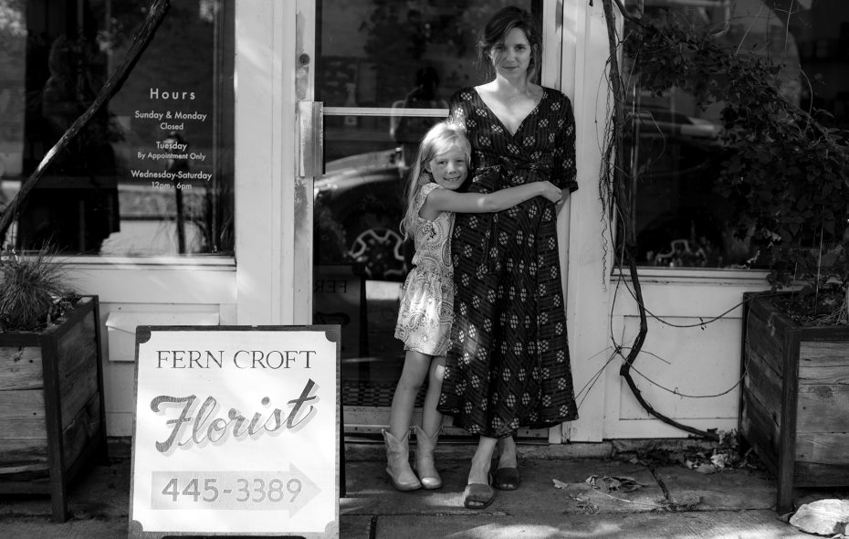 Fern Croft Floral owner Erin Lalley-Bauer and her daughter outside her Bryant Street shop. (Katie Friedman)