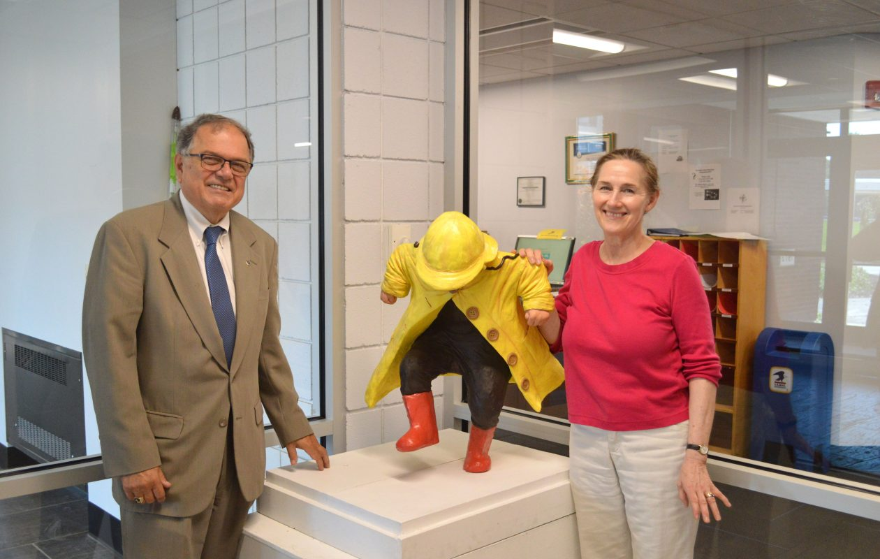 Niagara County Community College Interim President William J. Murabito and artist Susan Geissler pose with Geissler's 'Puddle Jumper,' donated in September 2018 to the NCCC Child Development Center. (Contributed photo)