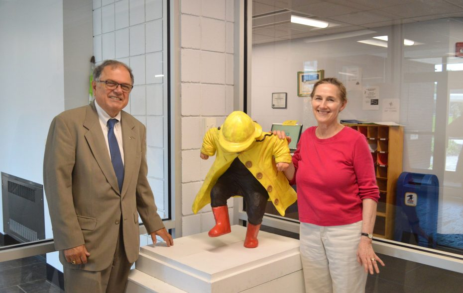 """Niagara County Community College Interim President William J. Murabito and artist Susan Geissler pose with Geissler's """"Puddle Jumper,"""" donated in September 2018 to the NCCC Child Development Center. (Contributed photo)"""
