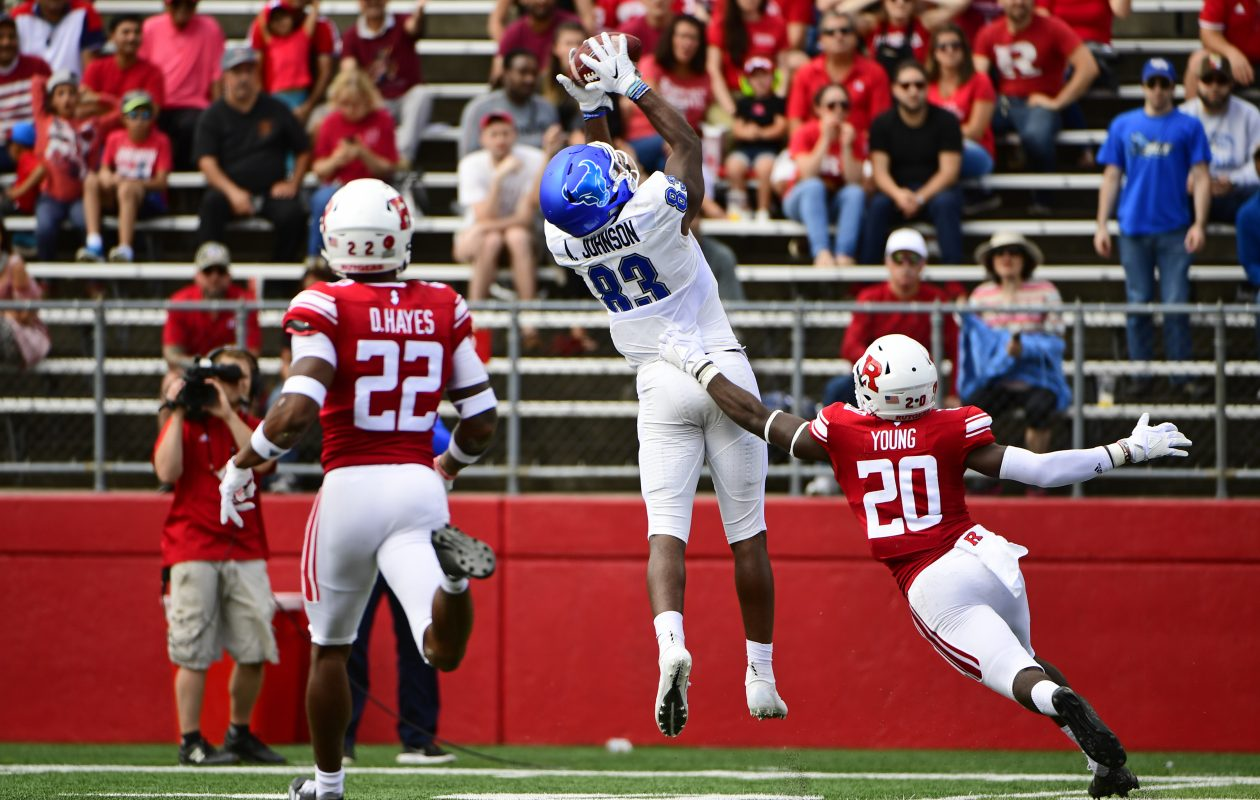 UB's Anthony Johnson catches a pass as Avery Young of the Rutgers Scarlet Knights defends and Damon Hayes looks on during the second quarter Saturday at HighPoint.com Stadium in Piscataway, N.J. (Getty Images)