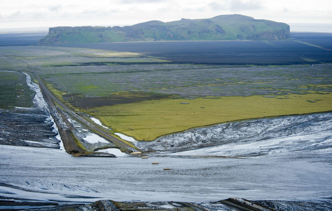 A picture taken on July 9, 2011, shows destroyed bridge after a massive flood of meltwater poured out of Iceland's Myrdalsjoekull glacier, raising fears of an eruption from the powerful Katla volcano underneath. (HALLDOR KOLBEINS/AFP/Getty Images)