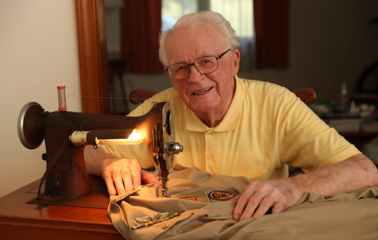 World War II veteran Herman Pawlicki, 97, sews uniforms for Veterans of Foreign Wars Post 5861 at his home in Elma on Sept. 7, 2018. He sews uniforms on his hand-cranked sewing machine. (Sharon Cantillon/Buffalo News)