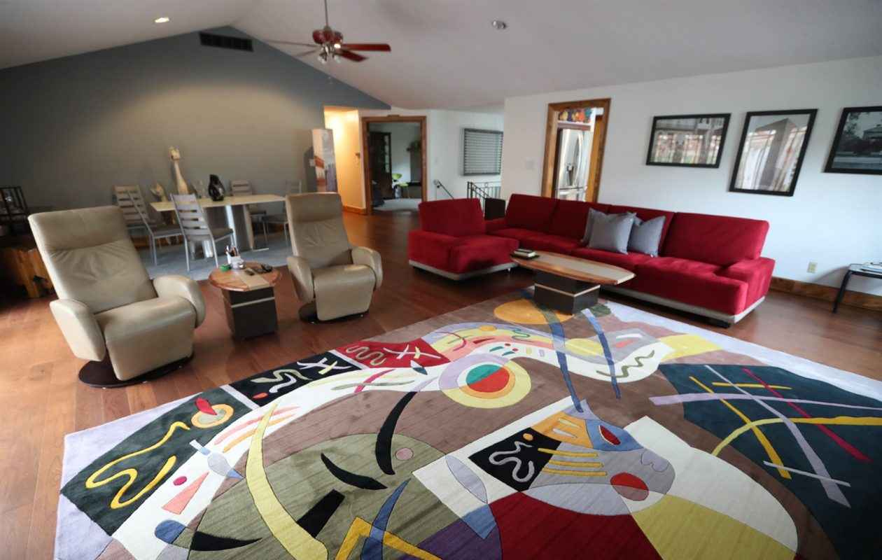 Peter BonSey and Jan Hamilton have lived in their Snyder home for 21 years. The living and dining areas are combined. (Sharon Cantillon/Buffalo News)
