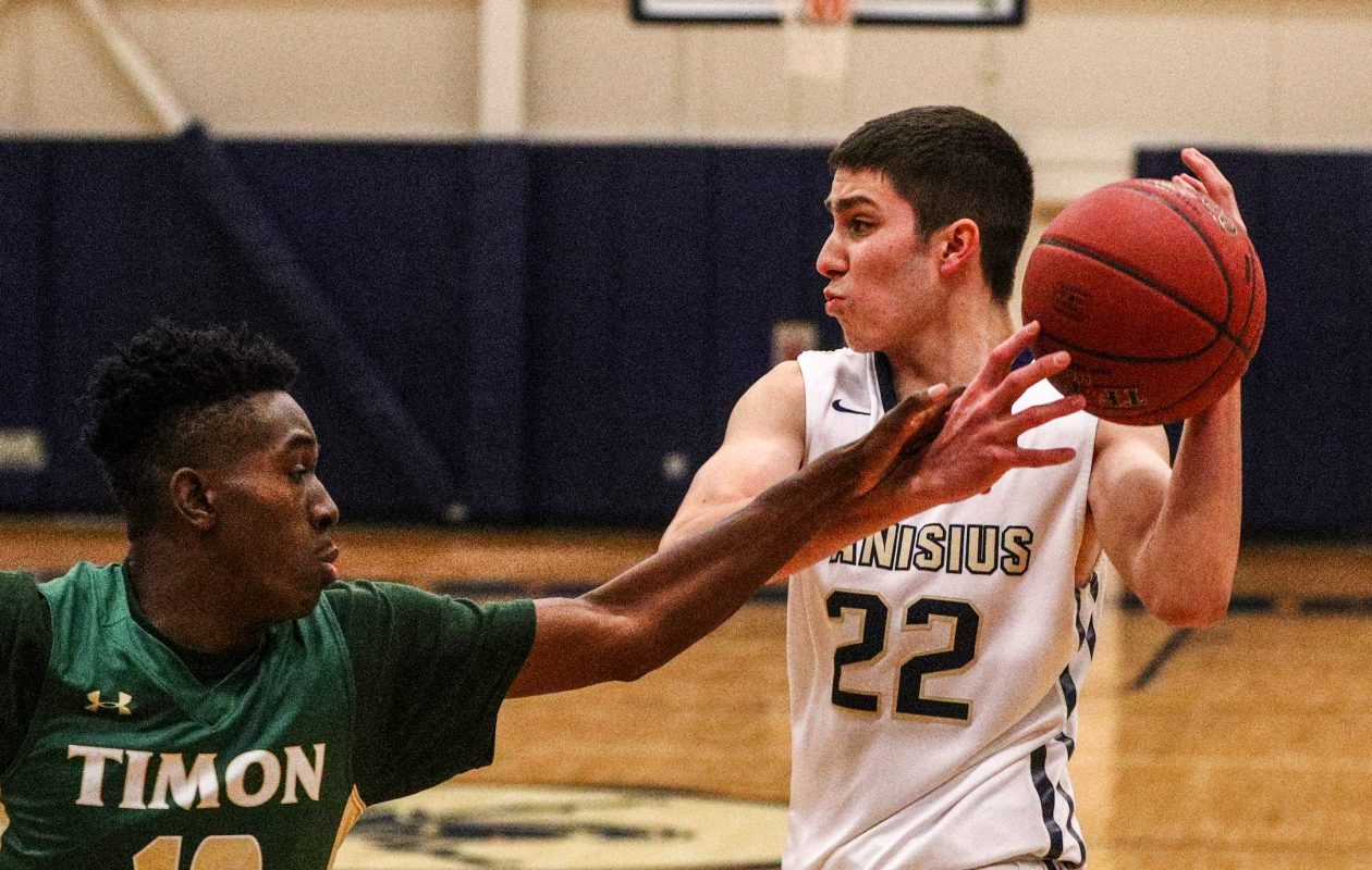 Timon's Julian Cunningham defends Canisius' Nick MacDonald during a game last season. Cunningham averaged 17.8 points per game.  (James P. McCoy/News file photo)