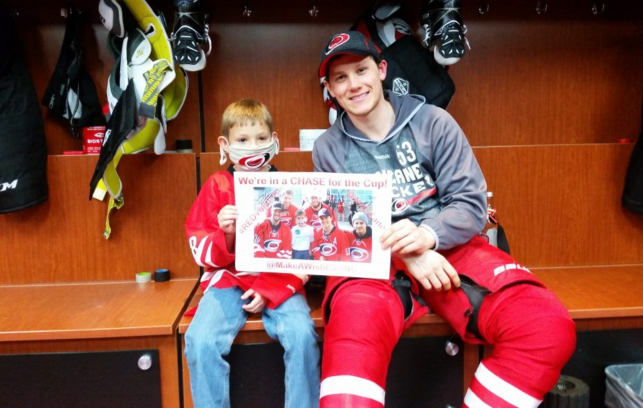 Chase Bass, left, poses with Jeff Skinner in the Carolina Hurricanes' locker room. Skinner befriended Chase, now a 9-year-old cancer survivor. Skinner will begin his first season with the Sabres on Thursday. (Family photo)