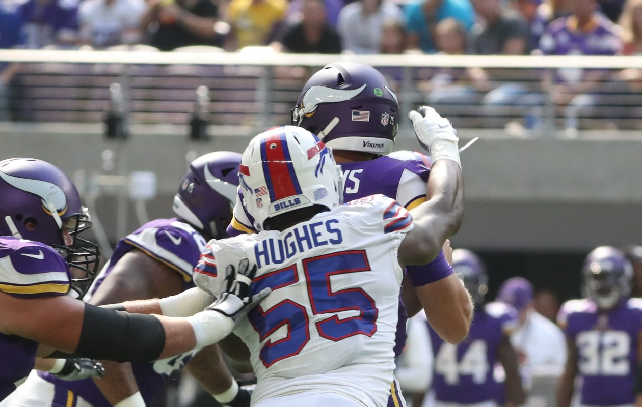 Bills defensive end Jerry Hughes puts pressure on Vikings quarterback Kirk Cousins. Hughes caused a fumble on this play in the first quarter on Sunday. (James P. McCoy/Buffalo News)