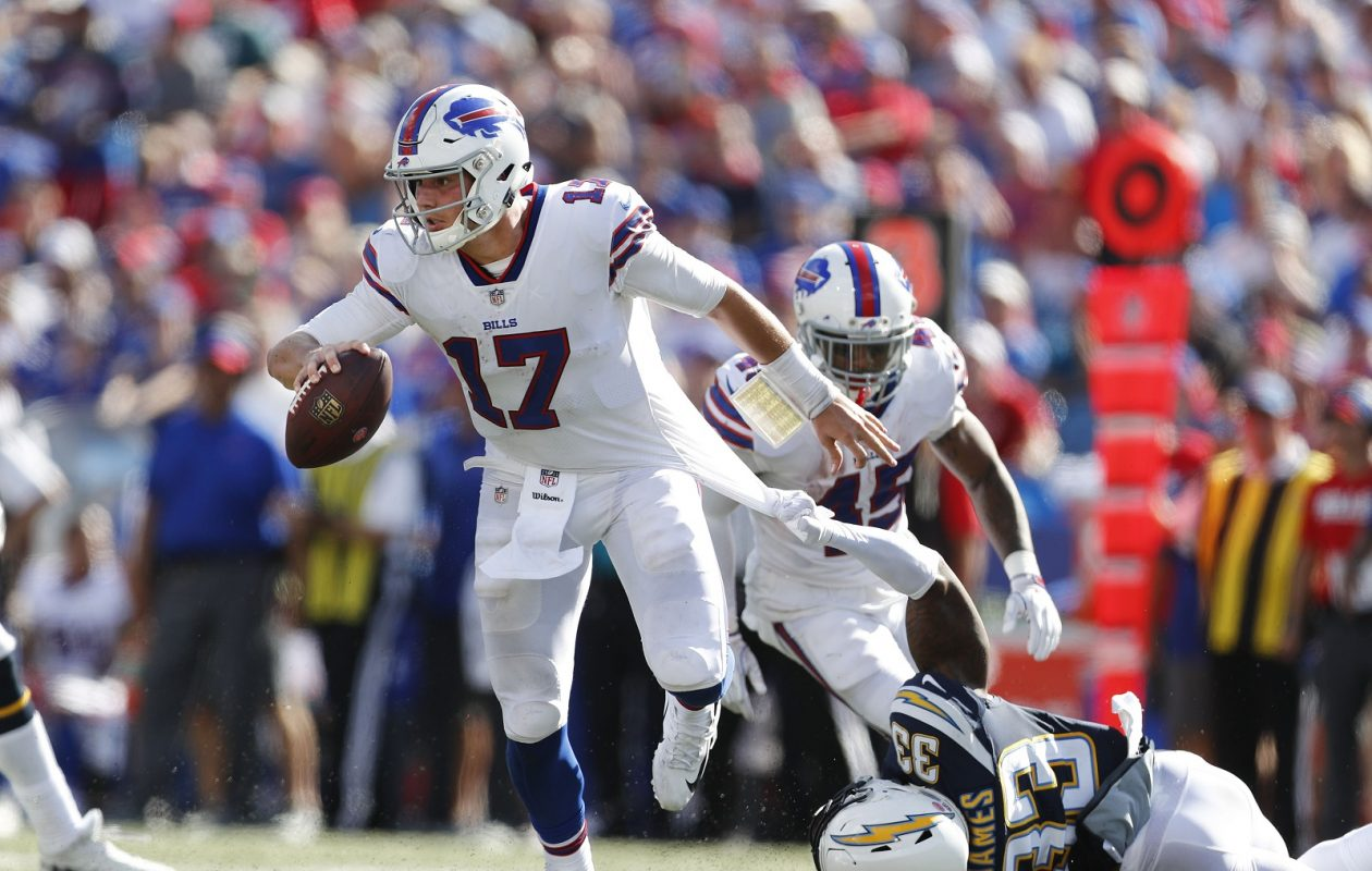 Buffalo Bills quarterback Josh Allen tries to get away from Los Angeles Chargers  Derwin James Sunday aa8b4edcb