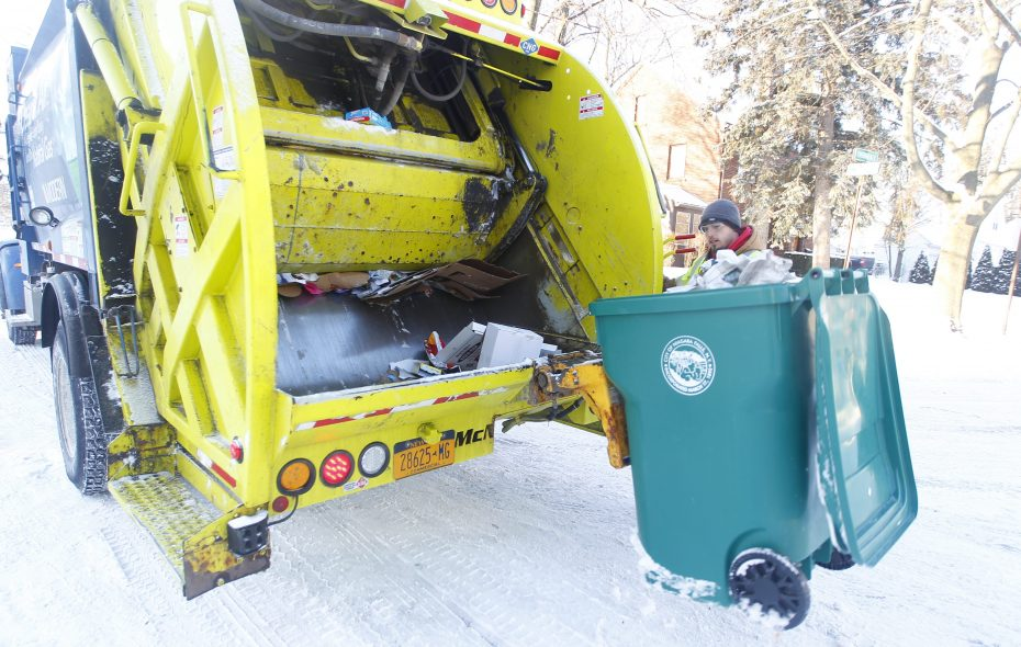 John Schmidtz empties a recycling tote on a  Modern Corp recycling truck at curbside pickup in Niagara Falls on Jan. 13, 2015.   (File photo/John Hickey/Buffalo News)