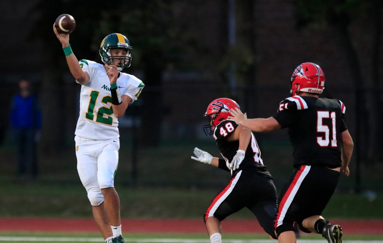 Joe Nusall passed for 182 yards and two touchdowns in helping Williamsville North edge Clarence, 41-35, in overtime Friday night in Clarence. (Harry Scull Jr./Buffalo News)