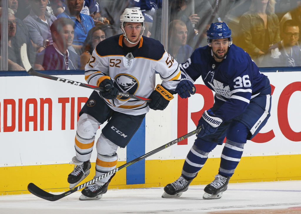Andrew Oglevie, who scored the Sabres' first goal, works against Josh Jooris Friday in Toronto (Getty Images).