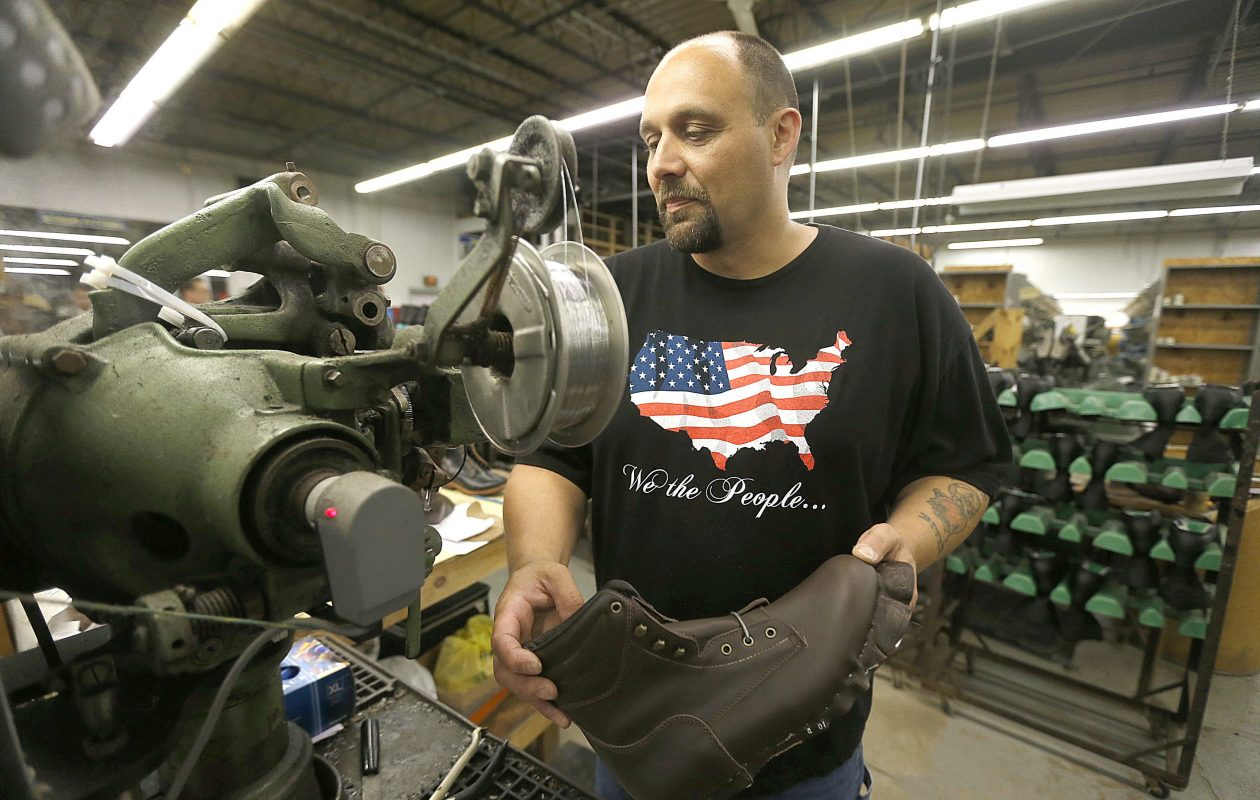 Christopher Hall works on a shoe-making machine in the 'side lasting' area of the plant at the  P.W. Minor shoe company in Batavia.  (Robert Kirkham/News file photo)
