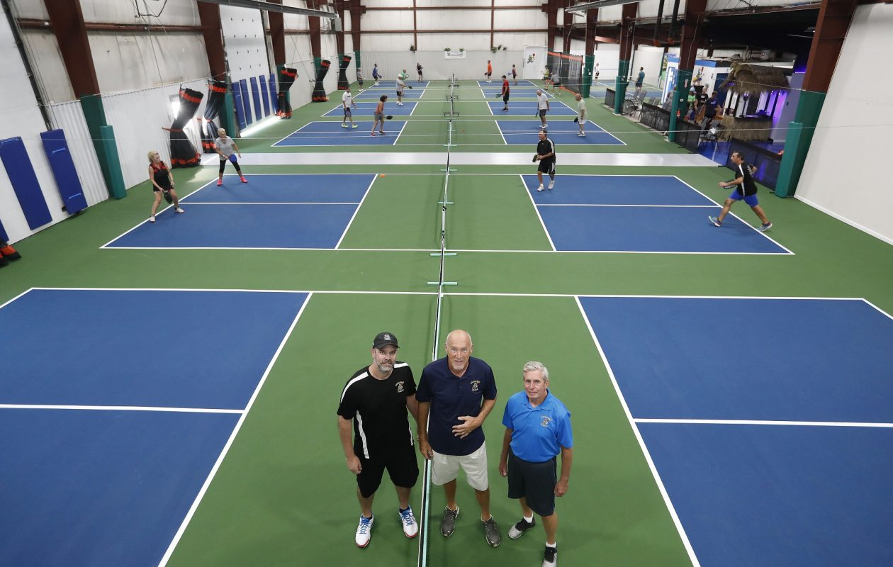 Pickleball Island founder and 'mayor' Ken Knight, center, enlisted the help of Jason Santerre, left, and David Miller, right, to help expand and run the pickleball center on Grand Island. Knight's brother, John, did much of the renovation work. (Mark Mulville/Buffalo News)