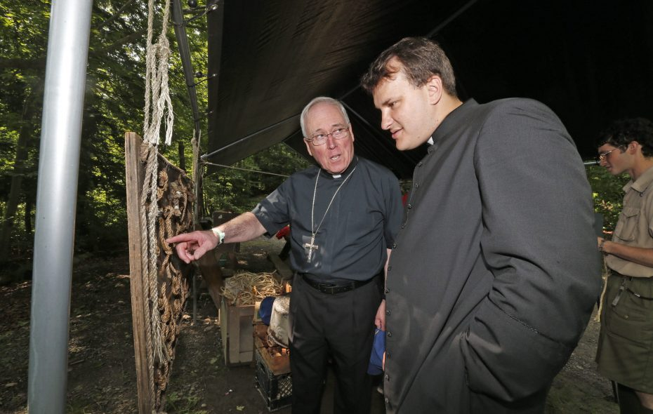 Buffalo Diocese Bishop Richard J. Malone talks with the Rev. Ryszard Biernat, right, in a 2014 photo. (Robert Kirkham/News file photo)