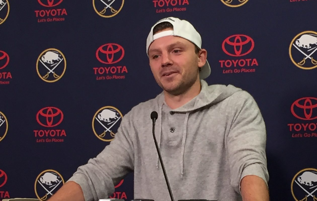 Sam Reinhart chats with reporters Thursday in KeyBank Center. (Mike Harrington/Buffalo News)