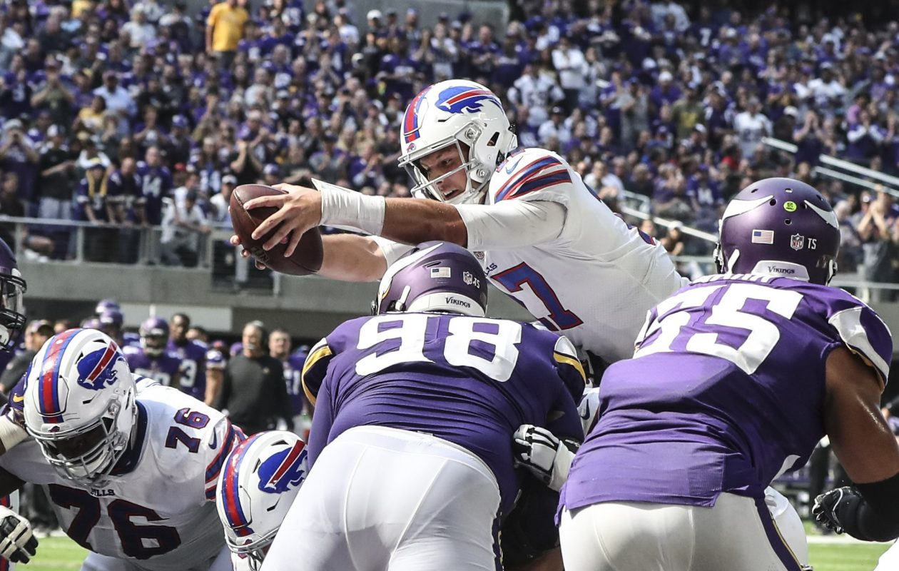 Bills quarterback Josh Allen (17) scores a touchdown on a quarterback sneak in the second quarter at U.S. Bank Stadium on Sunday.(James P. McCoy/Buffalo News)