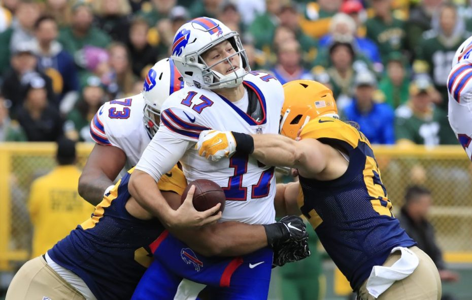 Josh Allen is sacked in the second quarter of a loss to the Packers. (Harry Scull Jr./Buffalo News)