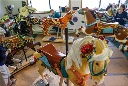 Volunteer woodcarvers and painters are painstakingly restoring the historic carousel that is planned to be installed at Canalside next year.