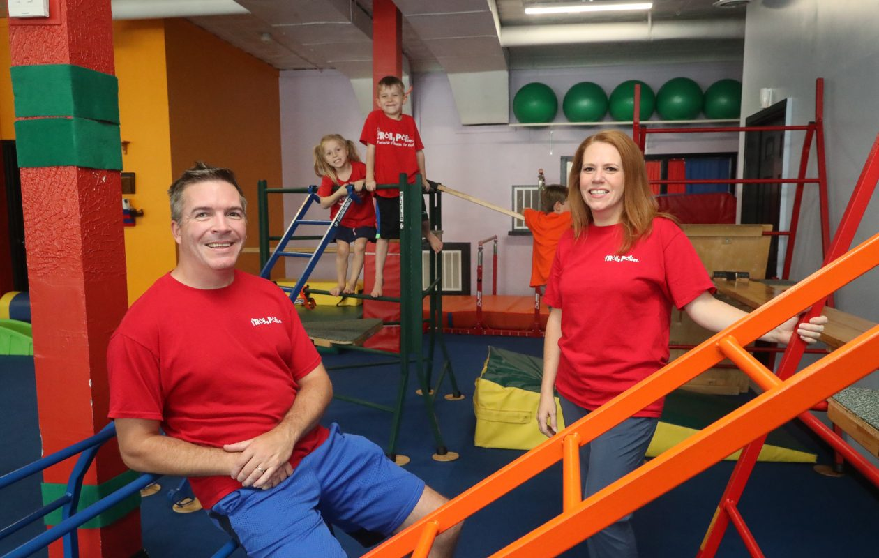 Jim and wife Danielle Fleckenstein, co-owners, at Rolly Pollies children's gym, have had trouble trying to fill open positions. (John Hickey/Buffalo News)