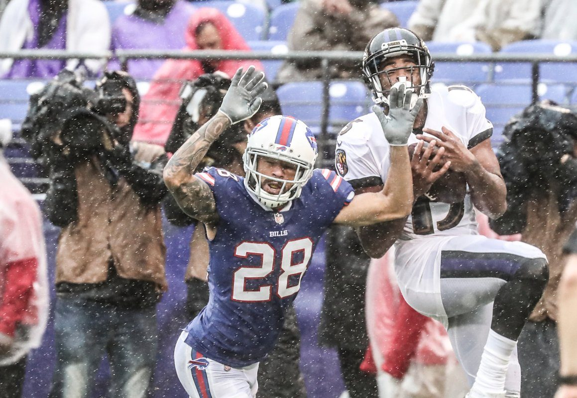 Phillip Gaines gives up a completion to the Ravens. (James P. McCoy/Buffalo News)