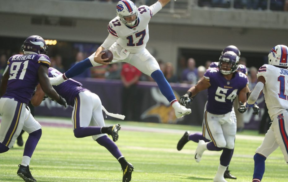 Bills quarterback Josh Allen hurdles Minnesota Vikings linebacker Anthony Barr. (James P. McCoy/News file photo)