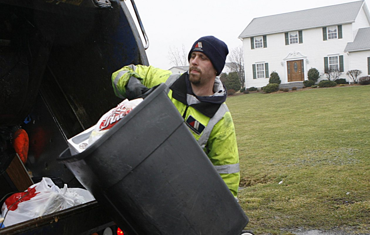 Patrick Winter of Modern Disposal picks up trash at a home on Lapp Road in Clarence. (Sharon Cantillon/News file photo)