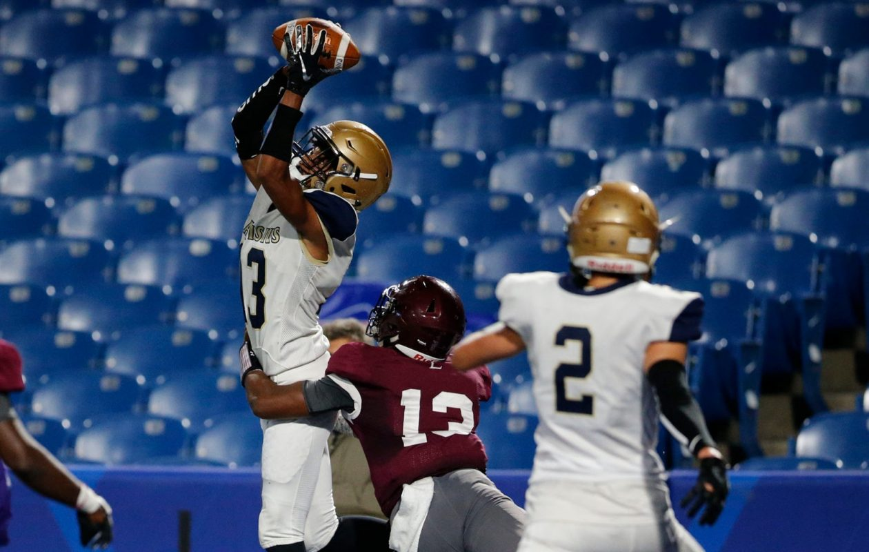 Canisius receiver Jason Martin pulls in a pass for the game-winning touchdown against St. Joe's with seven seconds left in the fourth quarter at New Era Field. Canisius won the game 34-28. (Derek Gee/Buffalo News)
