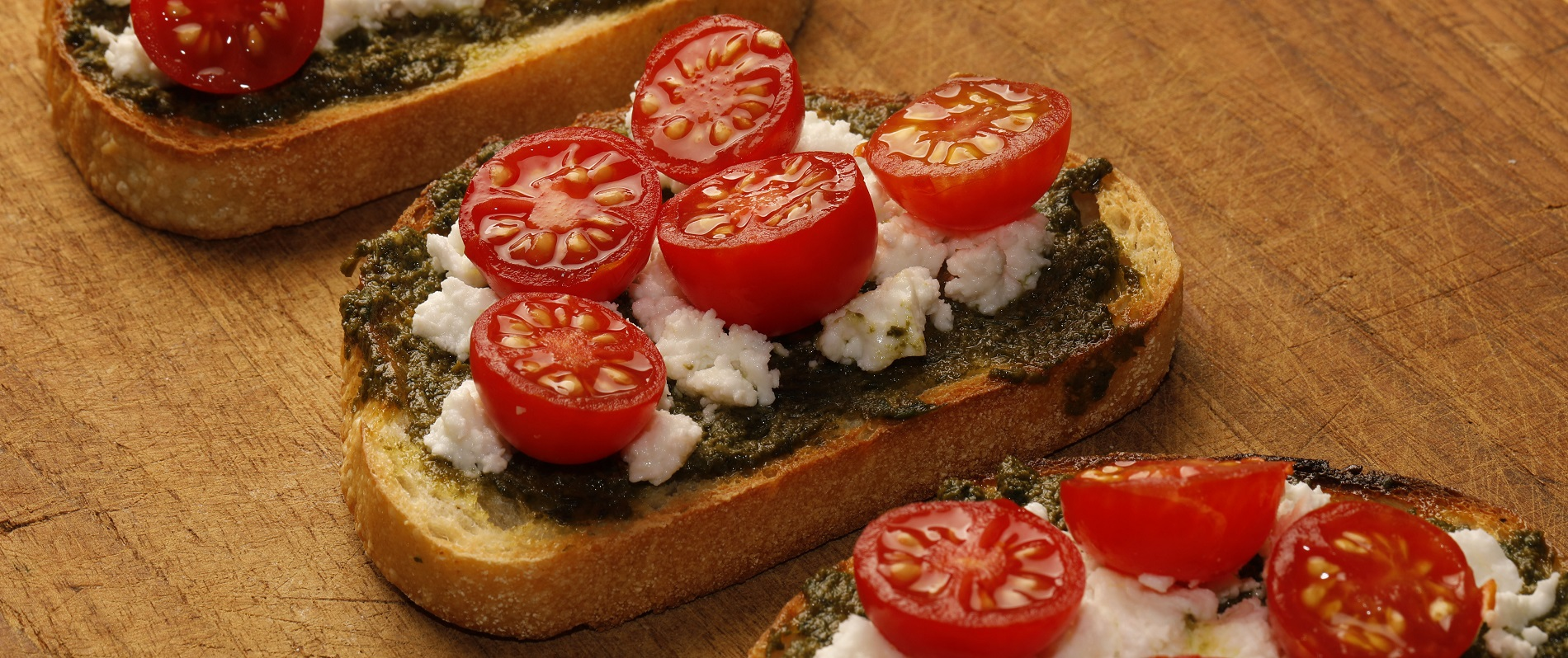 Andrew Galarneau says, 'Make no mistake: It takes a mortar and pestle to produce the most pristine pesto.' Pictured is crostini with tomatoes, smoked goat feta and Galarneau's handmade mortar-and-pestle pesto. (Derek Gee/Buffalo News)